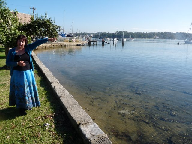 Karen Maber pointing out Carrs Park across Kogarah Bay
